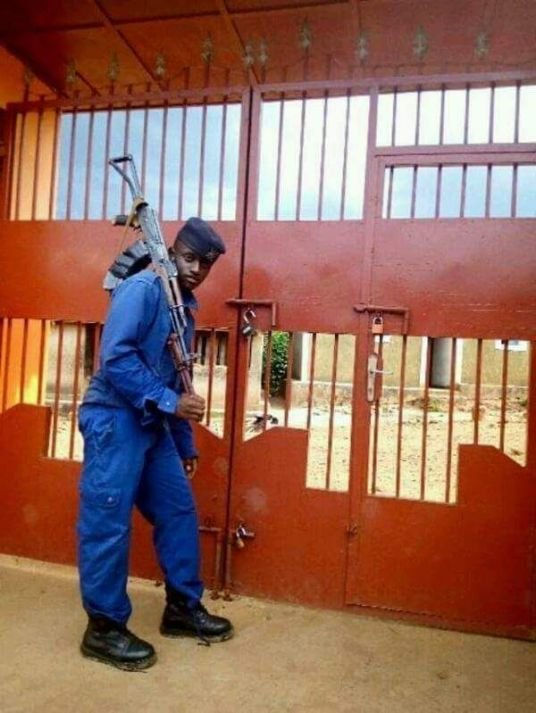 Imbonerakure in police uniform with weapon