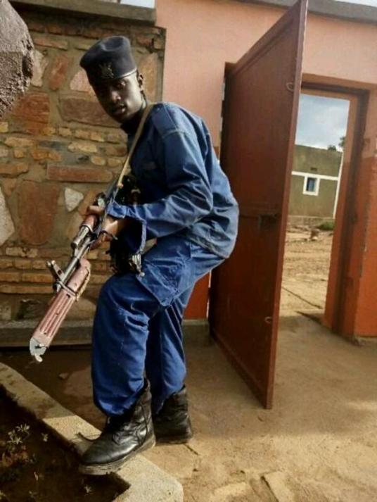member of the Imbonerakure militia in police uniform with weapon